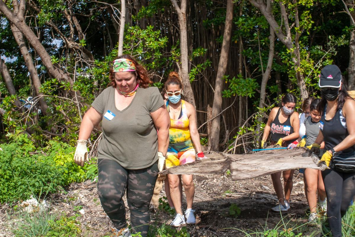 Esther Luft, owner of Virginia Key Outdoor Center, leads one of the clean-up crews.