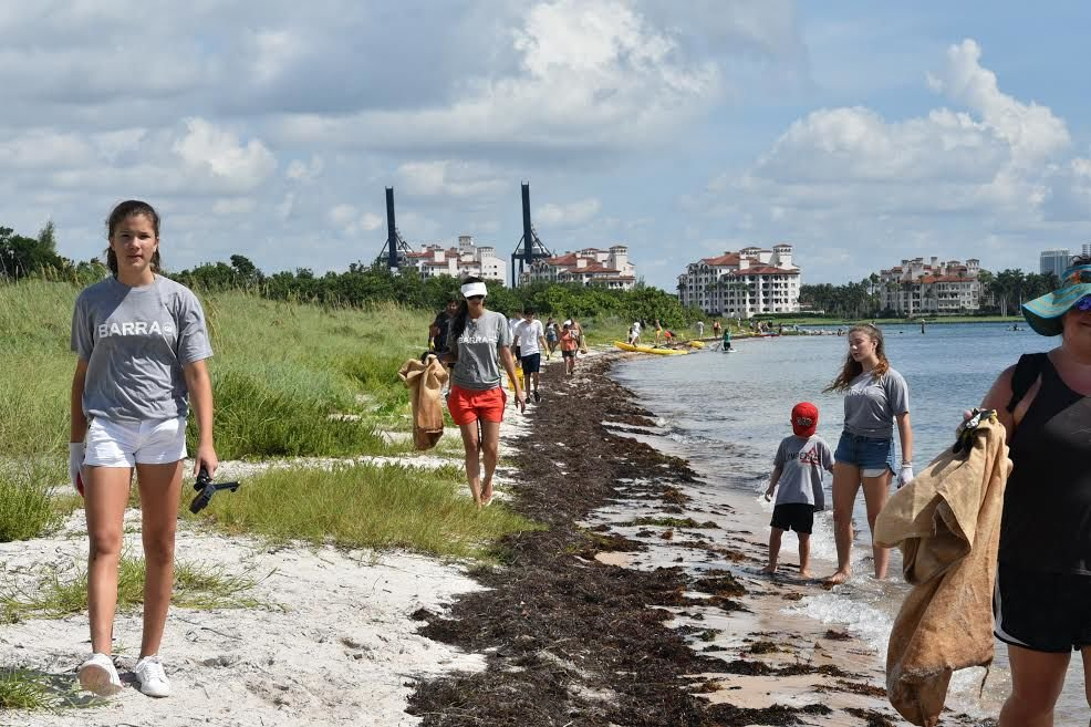 Volunteers pick up trash during the Virginia Key Historic Park anniversary morning clean up