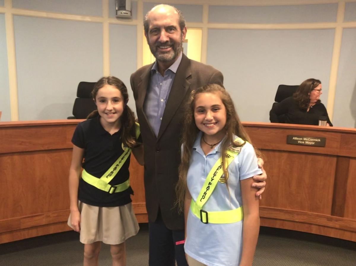 Council member Luis Lauredo with the KB K-8 center safety patrol members who led the Village council meeting in the Pledge of Allegiance. On the left is Claudia Cuenca and Luciana Gadala-María is on the right.