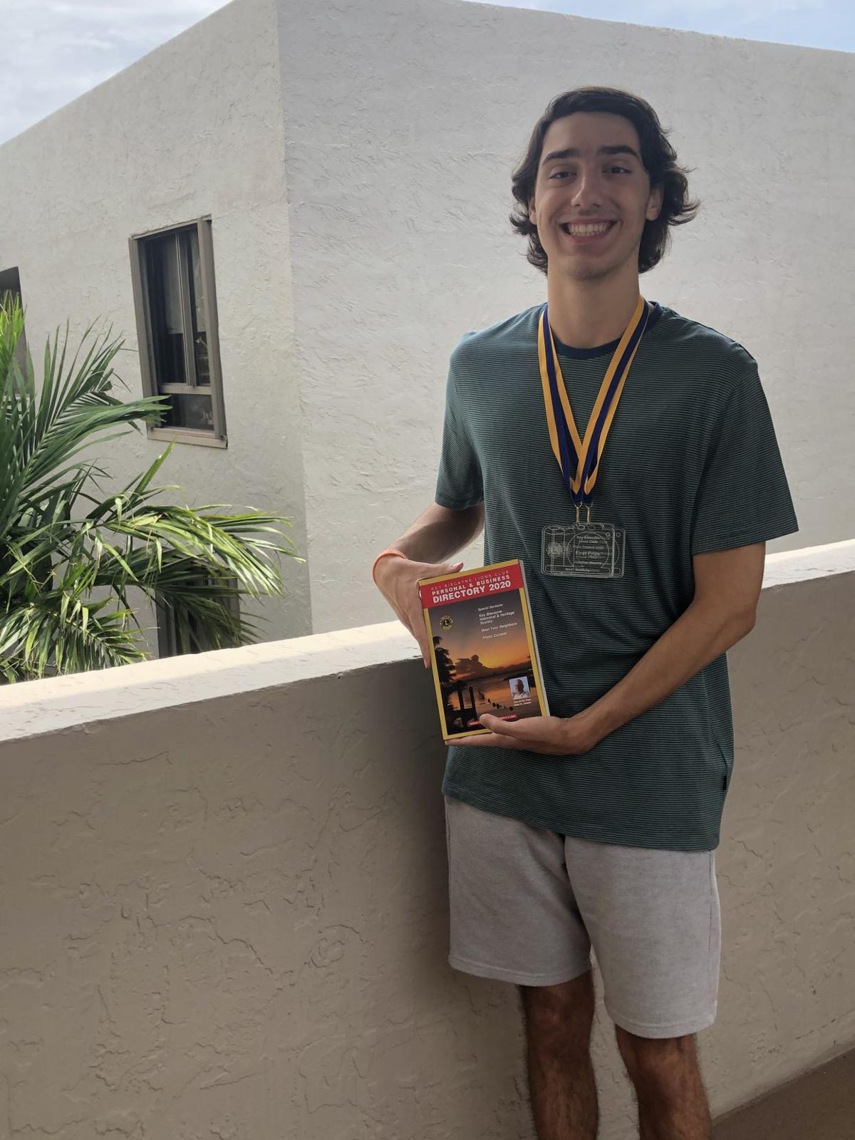 Jonathan Mendez with awards.jpeg