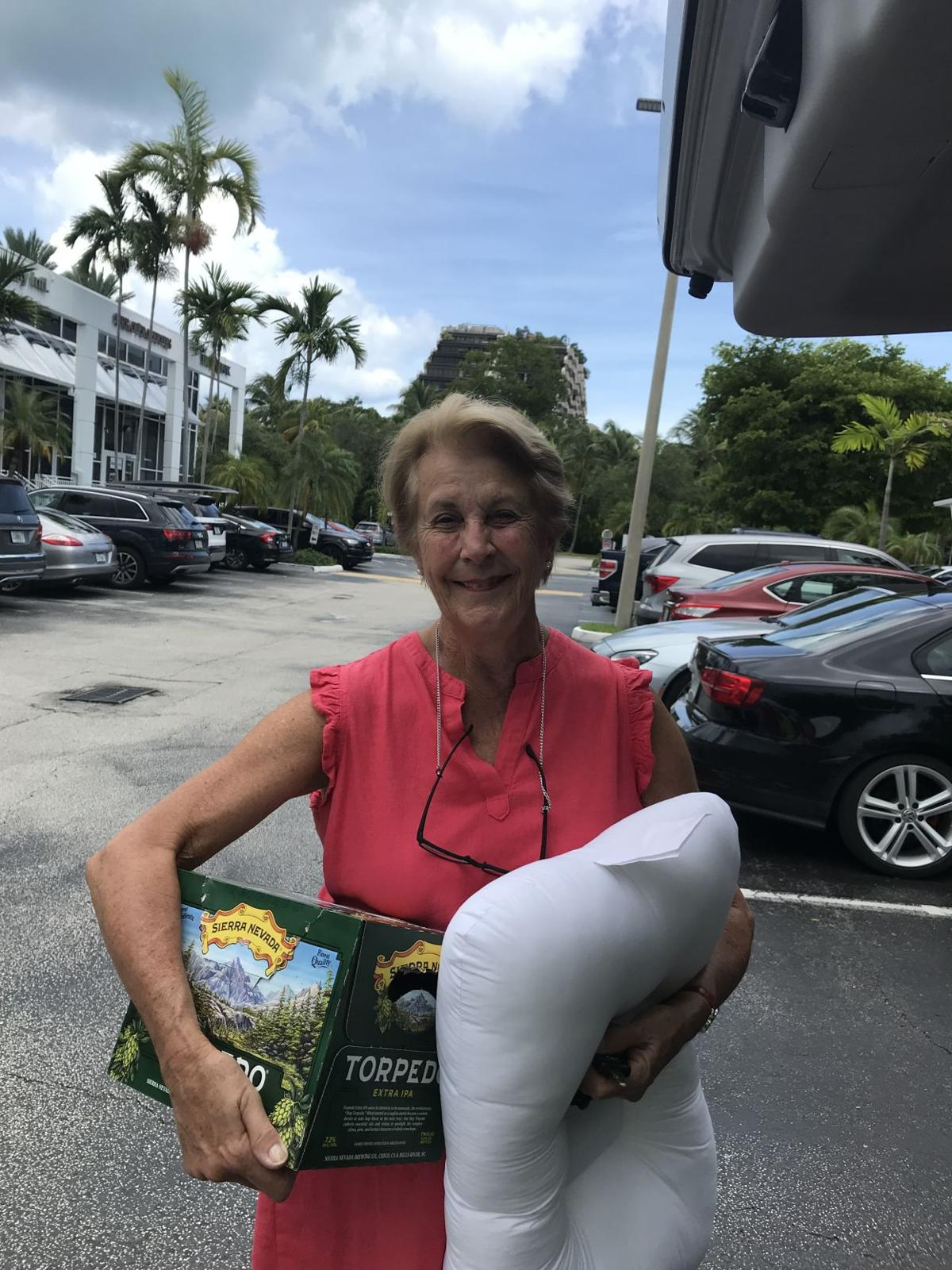 Elena Deschabelles unloads her donations of non-preservable food