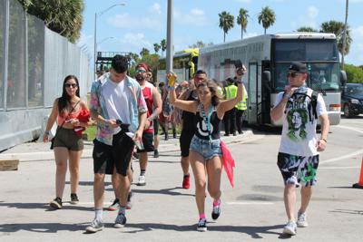 Ultra fans disembark from the buses on the afternoon of festival day one on Virginia Key March 29, 2019