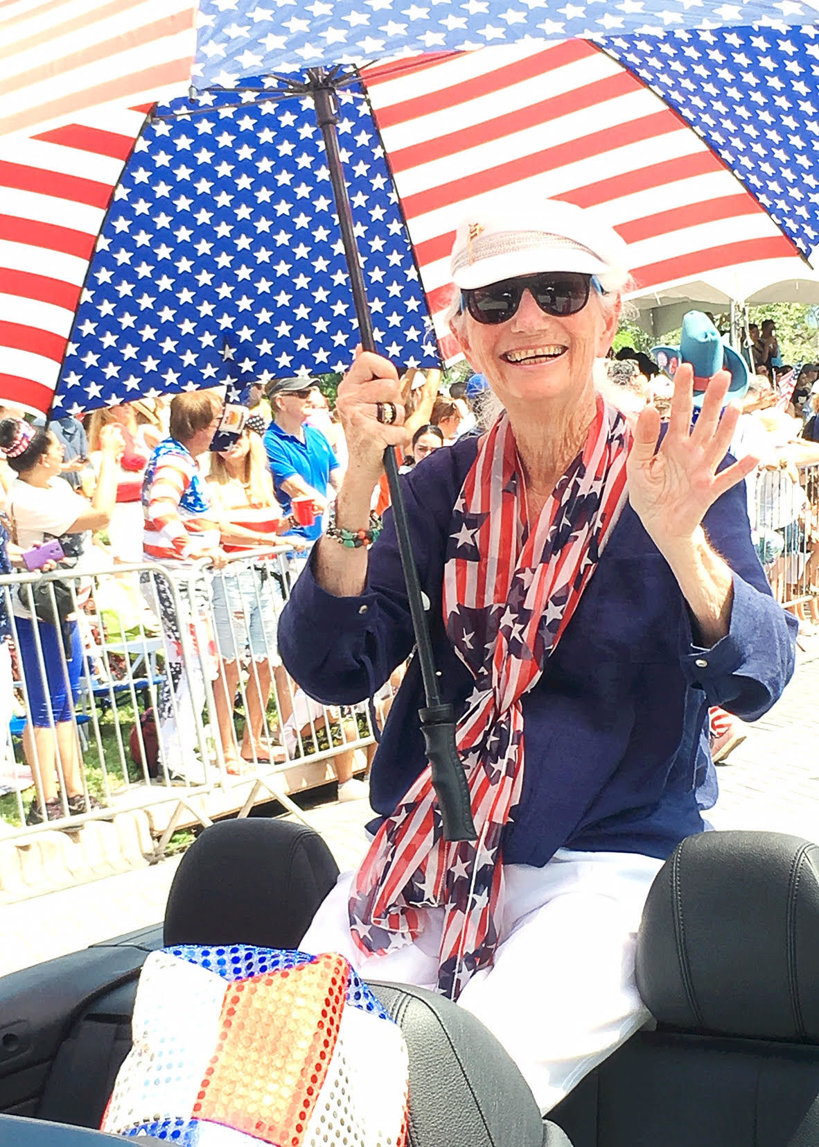 4th of July Parade Grand Marshall Judi Koslen waves to her fans