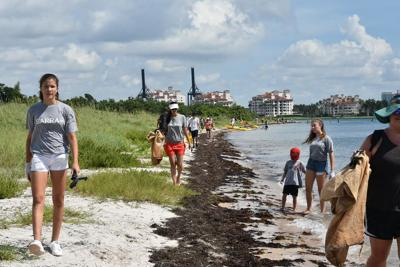 Kids of all ages clean up Virginia Key Historic Beach