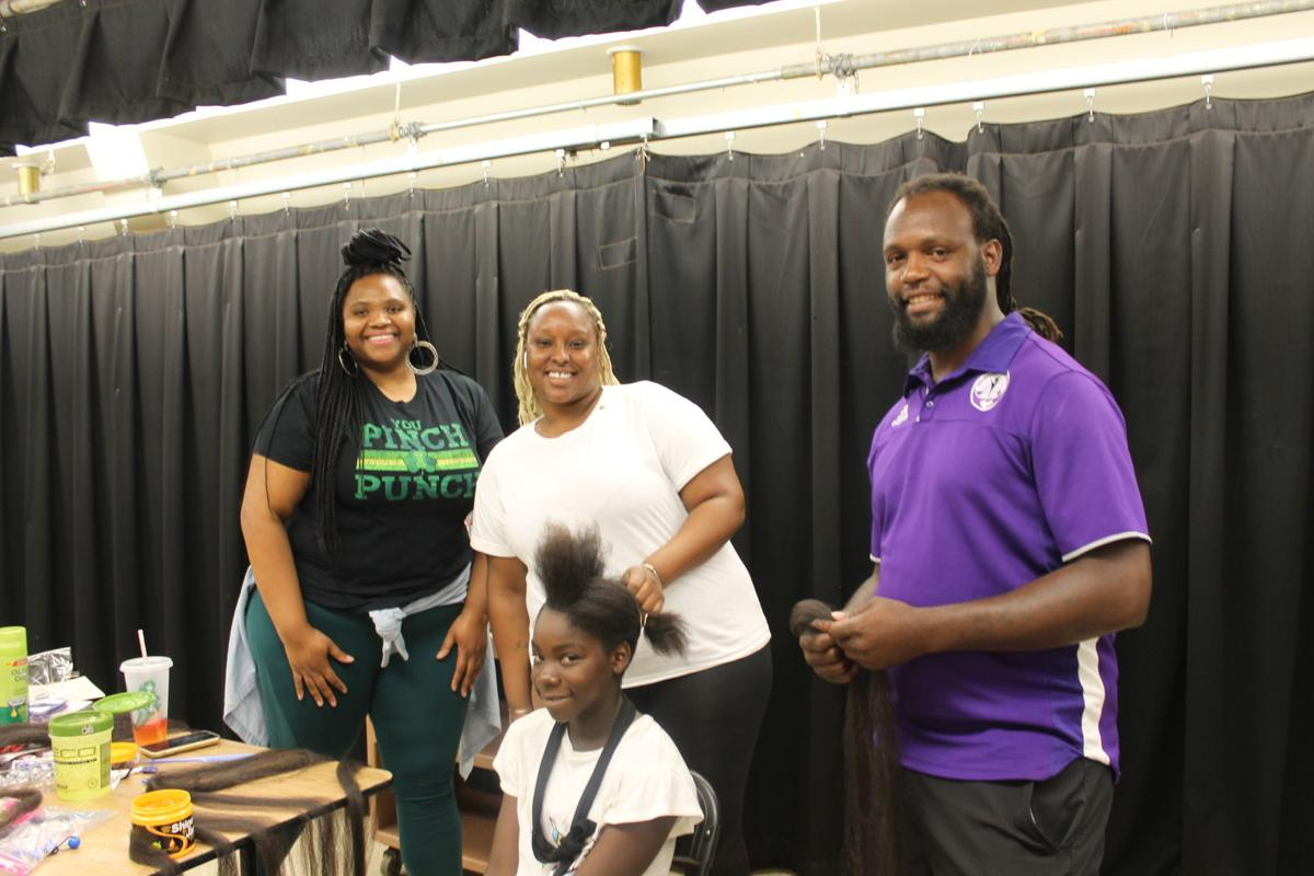 (L to R) Wahtinna Fowles and Miya Allen, and MCI's Angel Johnson get Ashanti ready for 7th grade