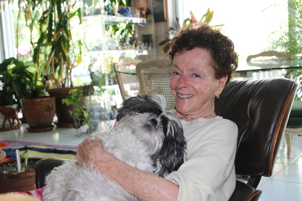 Director Emeritus Judy Reinach at home with her fundraising partner Kalie the Shih Tzu