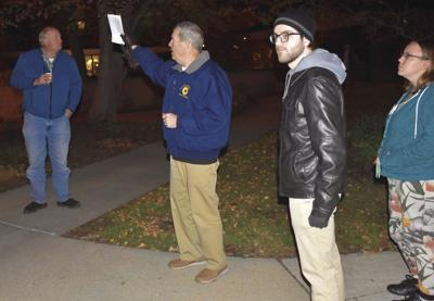 Joe Newport, the ISU Police Chief leads the tour inspecting the lighting issues on campus.