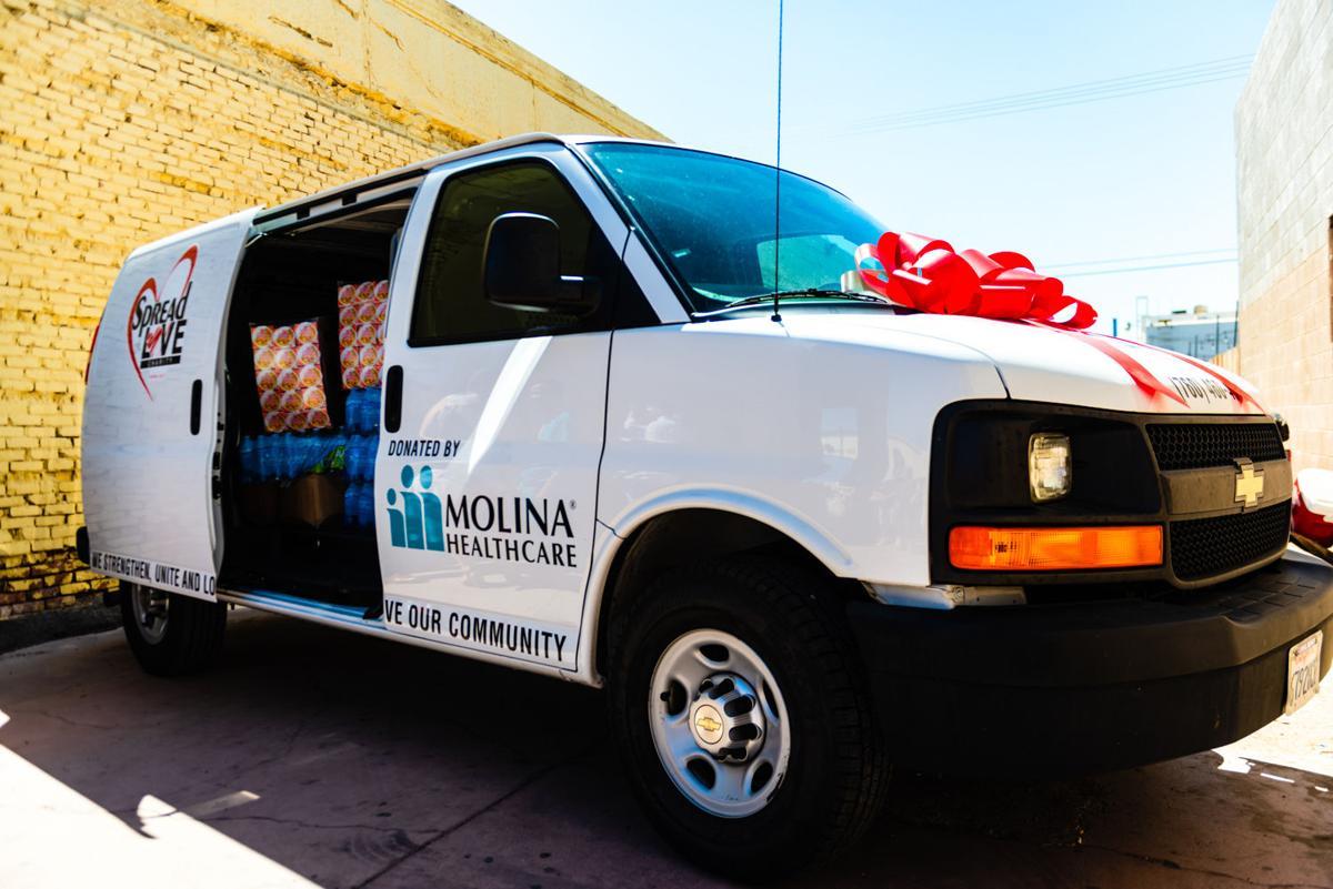 Molina donates van to Spread the Love Charity