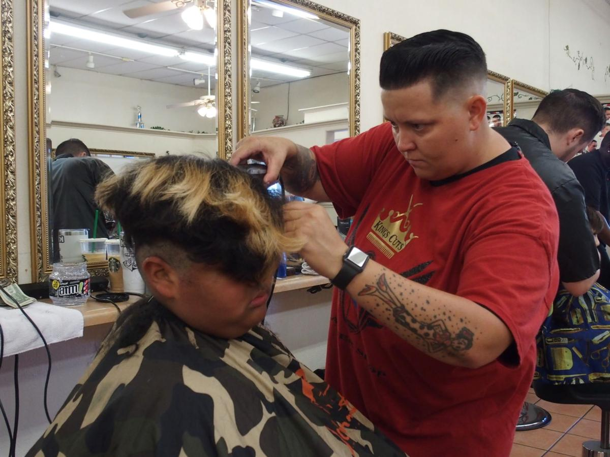 School kids get free haircuts at beauty academy
