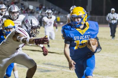 Wildcats dig out of hole to bury Kearny, 44-28