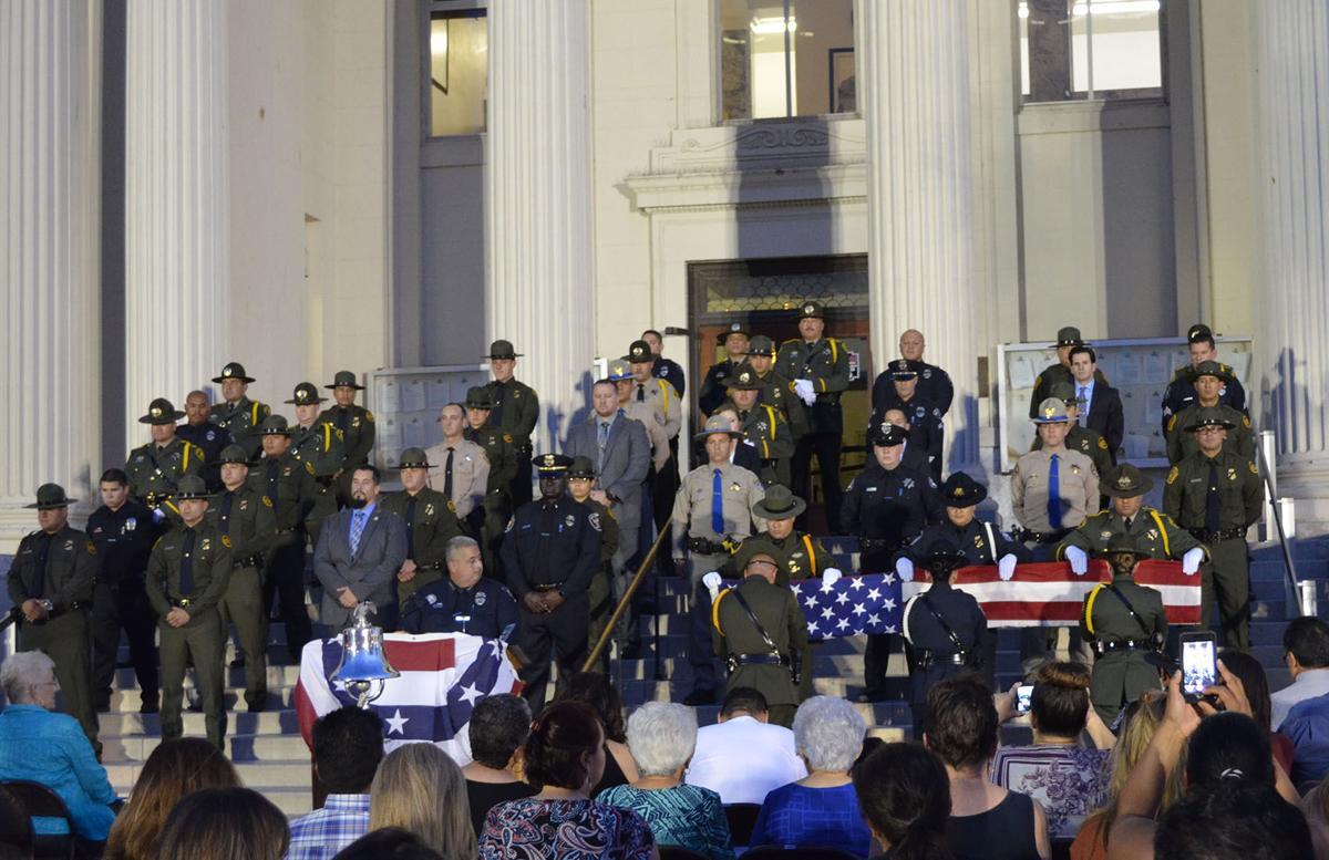 Somber memorial honors fallen law enforcement officials