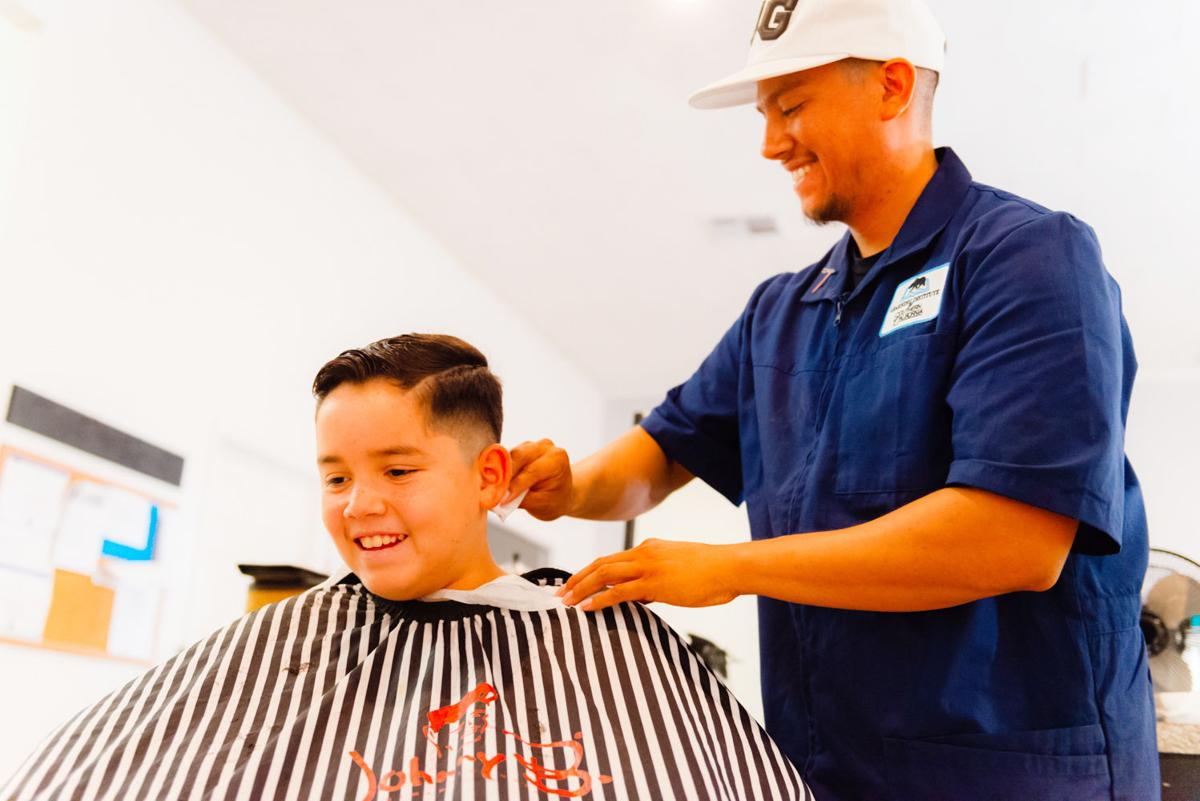 50 local students receive free back-to-school haircuts