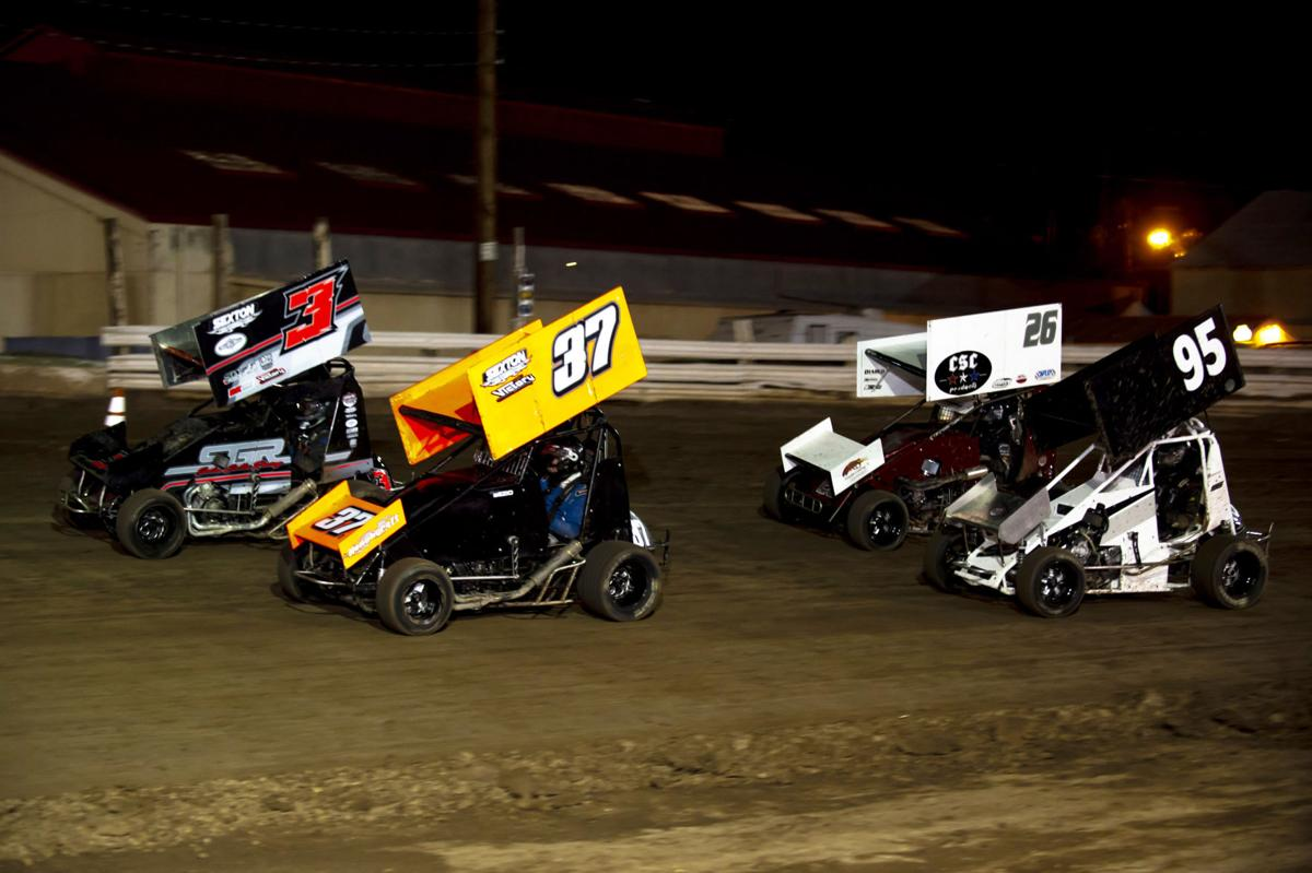 Lightning quick:   Mini cars compete in lightning sprints at the IV Fairgrounds