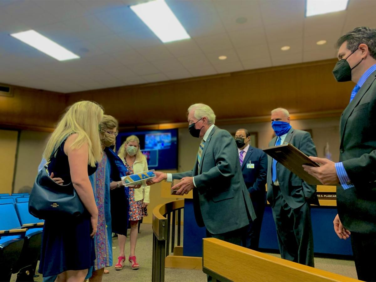 County board honors Kevin Kelley
