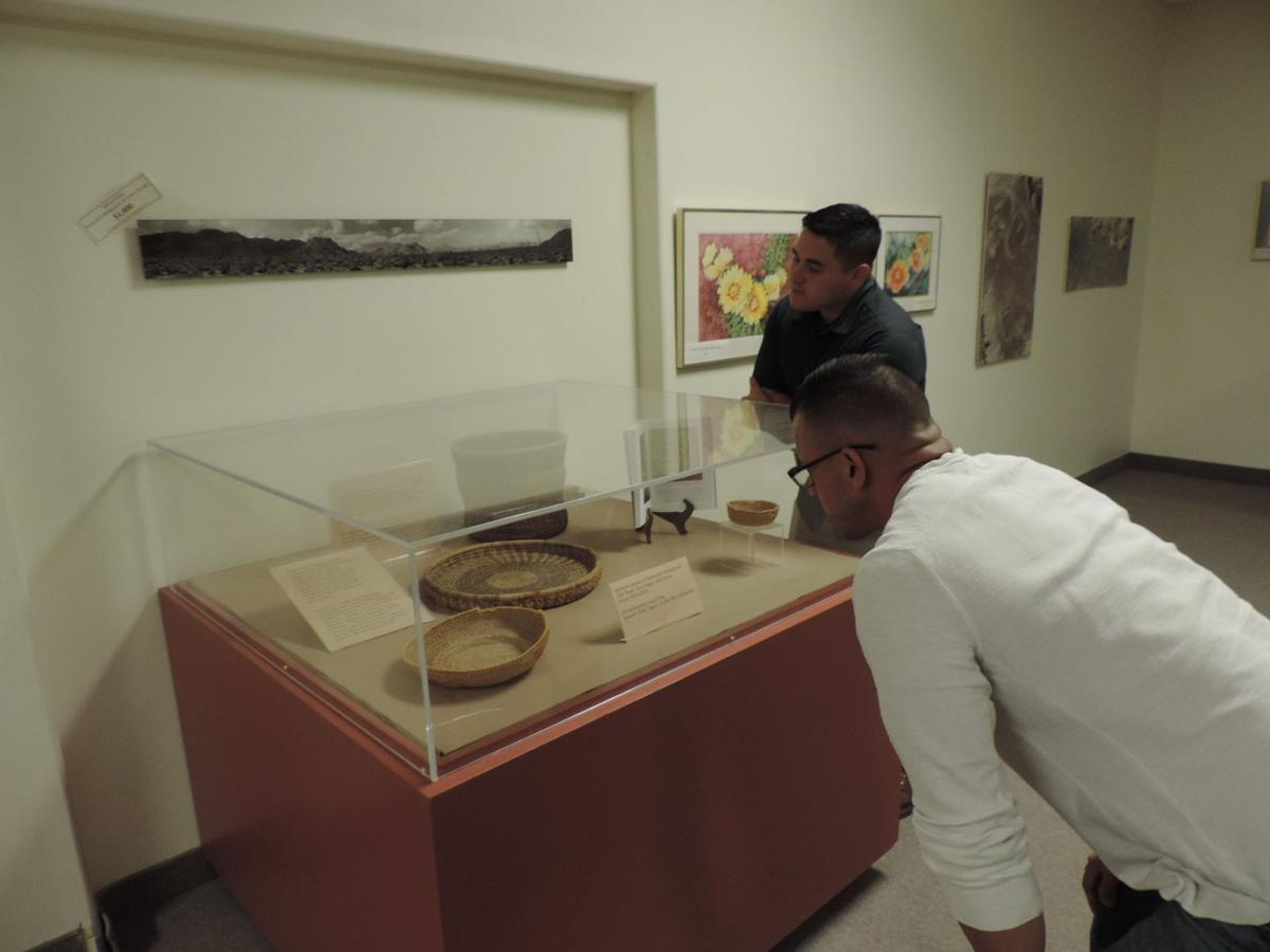 Museum Visitors looking at temporary basket exhibit