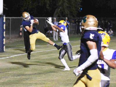 Wildcats lose in penalty-plagued affair