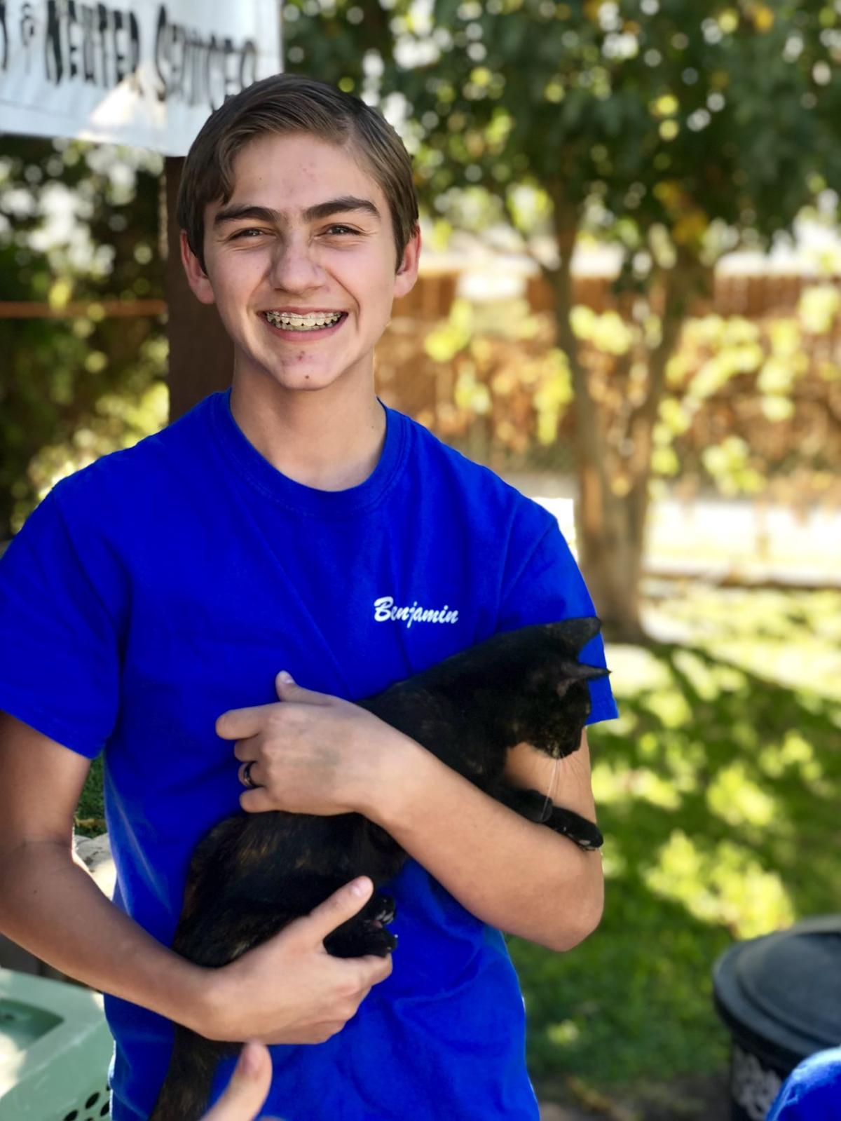 Club celebrates National 4-H Week with gift to pet rescue