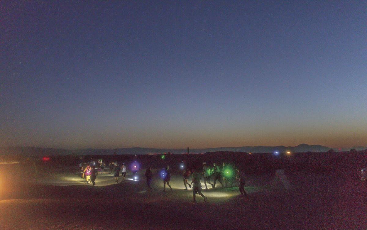 Runners navigate the dark during 15K race