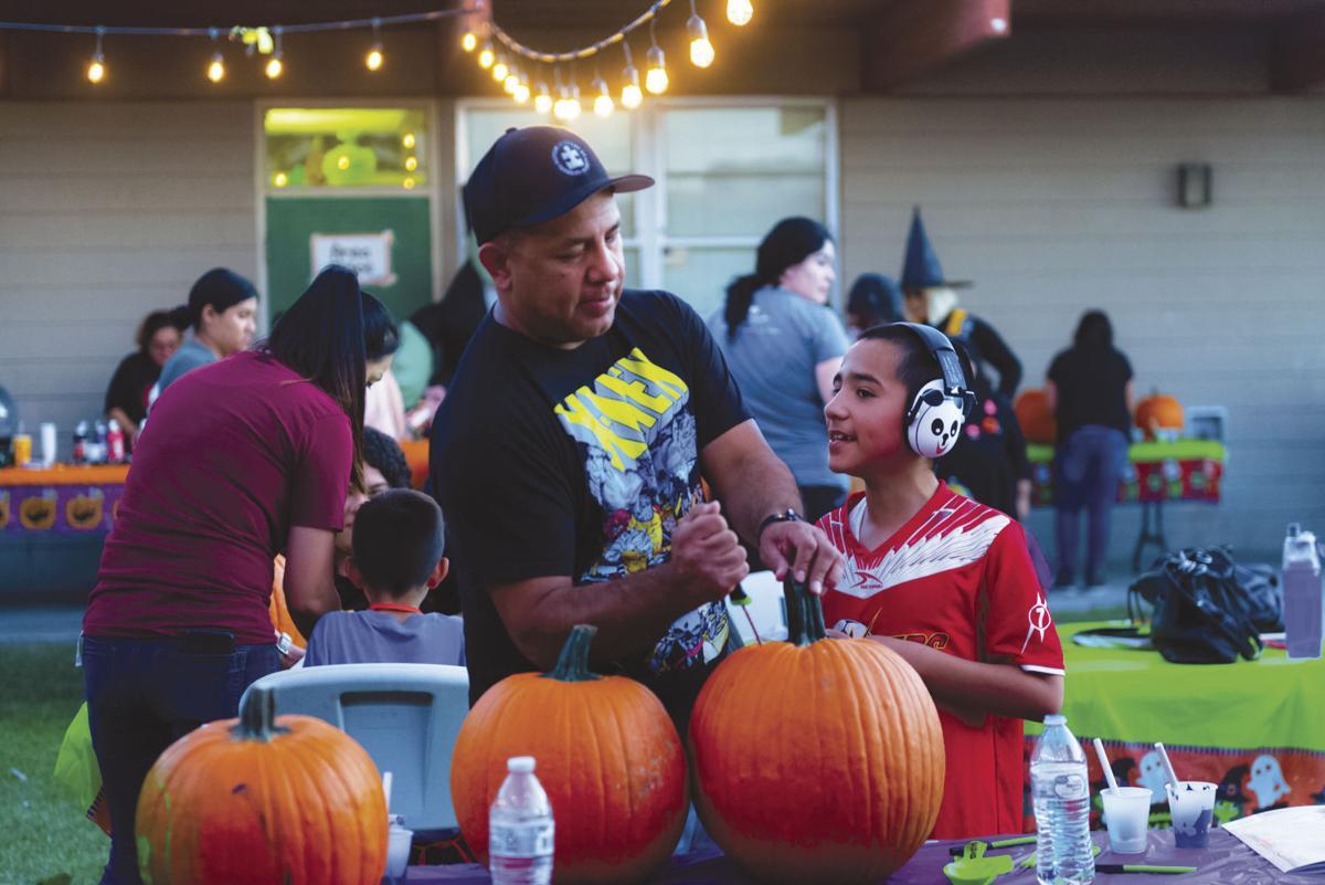 Pumpkin carving event helps autistic kids socialize