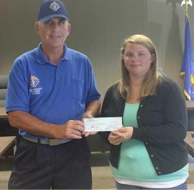 New Holstein Knights of Columbus Council #12393 Grand Knight John Klinzing presents a $500 check
