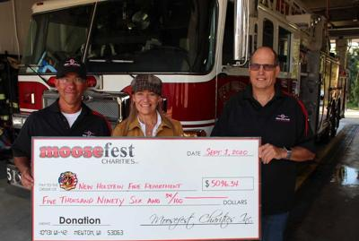 Cheryl Vogel of the Smiling Moose in Osman presented a ceremonial check