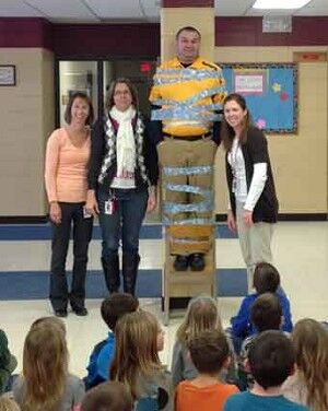 PAW Points earned by students gets principal duct taped to the wall