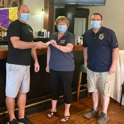 Collins State Bank presented the New Holstein Lions Club with a check