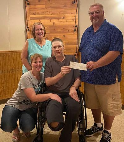 Co-Chairs present check from Benefit Brat Fry for Adam Faust