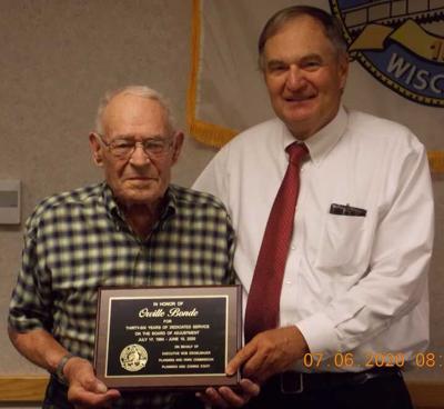 Ziegelbauer presents Orville Bonde with a plaque