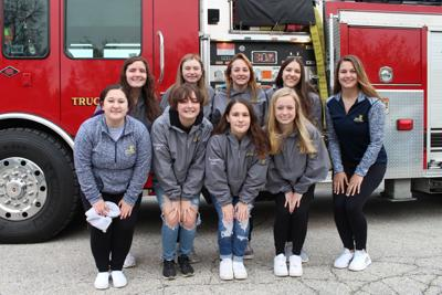 After winning State Kick again, CHS dance team gets fire truck ride to school
