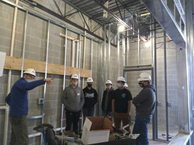 Kiel High School Technical Education teacher Ted Bonde and his construction class tours performing arts center