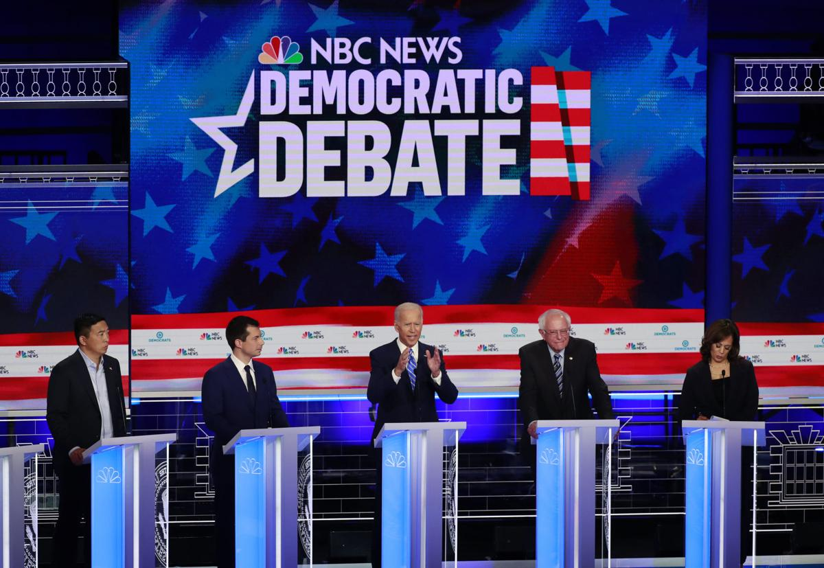 Democratic candidates take on health care, immigration and Trump in first debate