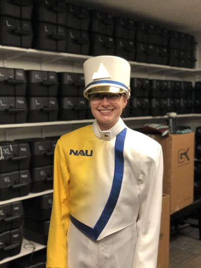 Jennifer John poses in the Lumberjack Marching Band's drum major uniform