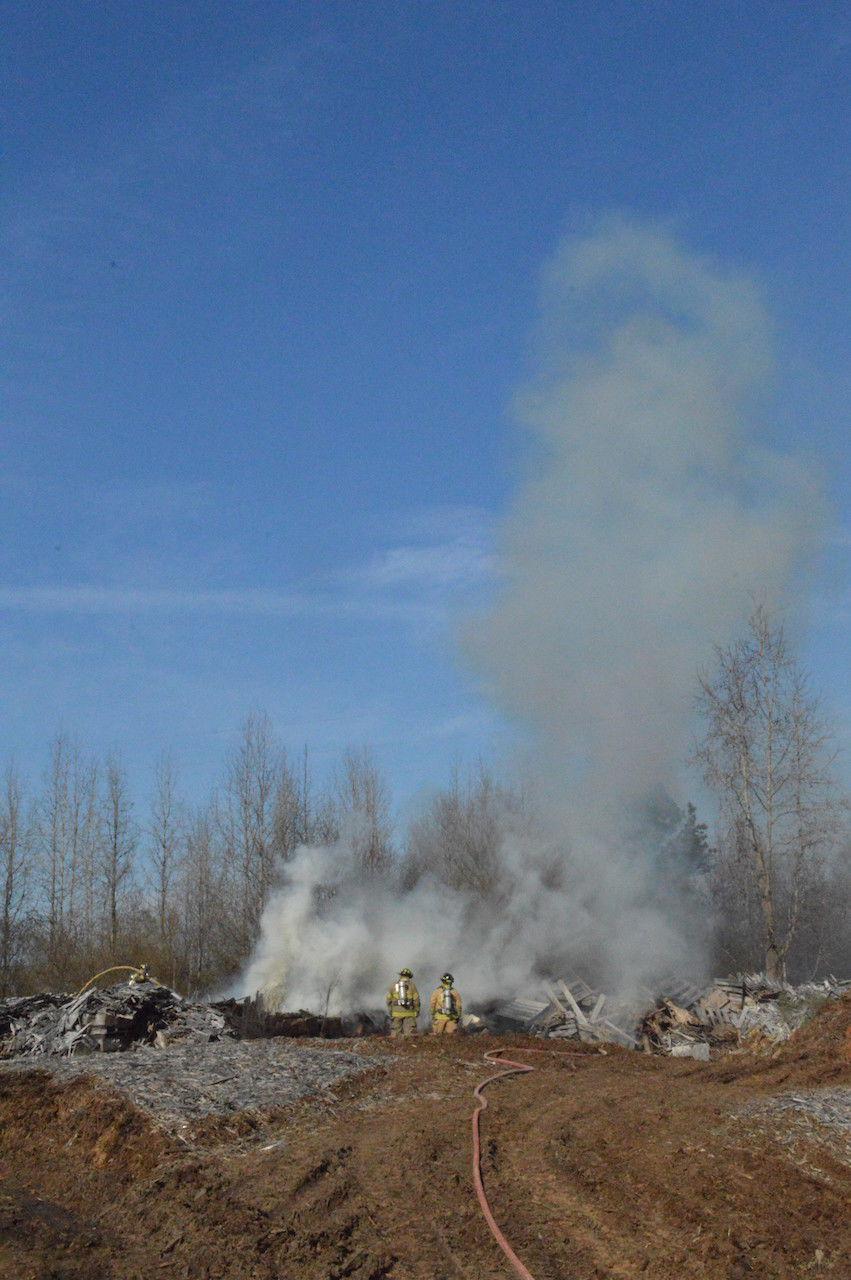 Firefighters battle pallet blaze