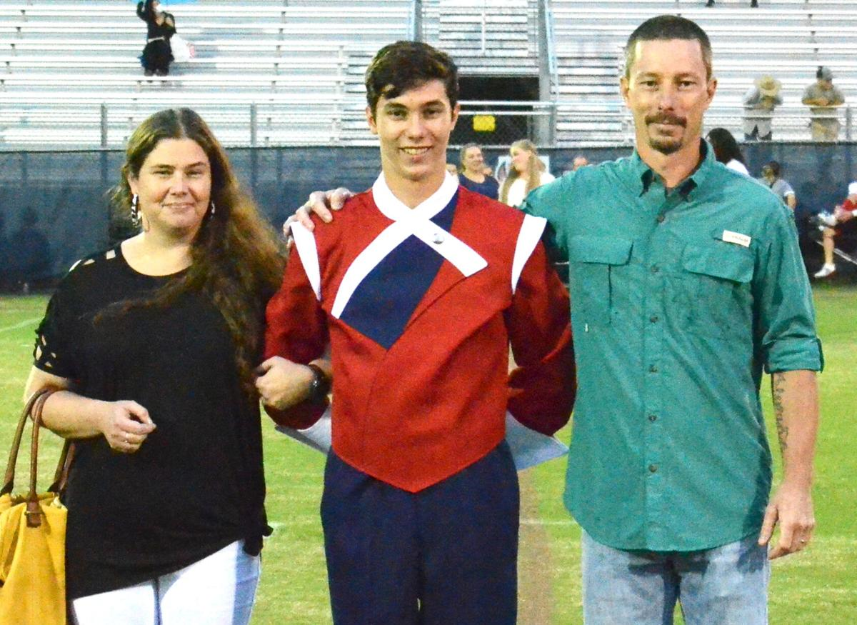 Hunter Cassidy with father, Adam Cassidy, and mother, Crystal Cassidy.jpg