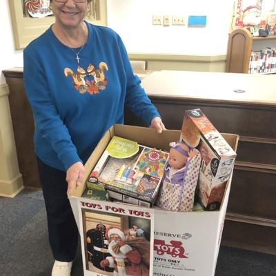 Butts County Library accepting canned food in place of fines, and toys for Toys for Tots