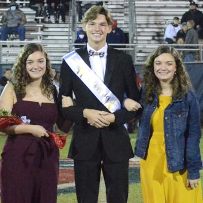 Jay Cosby, escorted by his best friends, Gabby and Gracyn Edmonds.jpg