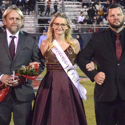 Lauren Boling escorted by father Eric Boling and step-father Jeremy Toney.jpg