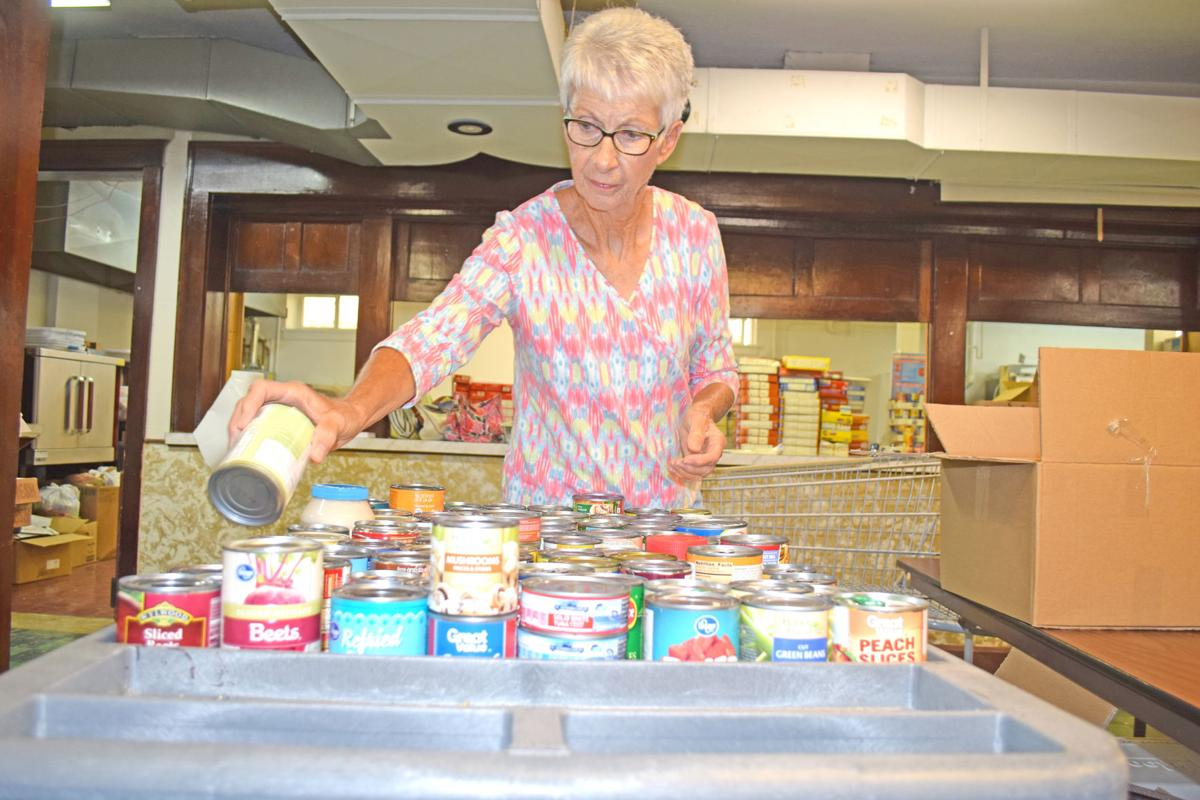 Wheels of hope to open invitation only distribution site in volunteer ruth gfeller sorts canned food for wheels of hope aug 16 checking the expiration date to see if its still edible stopboris Choice Image
