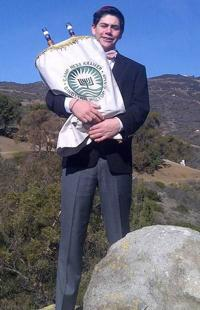 <p>Jacob Cohen poses at the Hilltop chapel at the Gindling Hilltop Camp in Malibu, California, in 2015, after becoming a bar mitzvah. Cohen and his family are members of Temple Chai.</p>