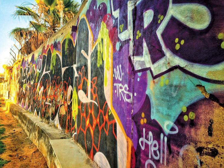 Graffiti covers a wall at a Tel Aviv park.