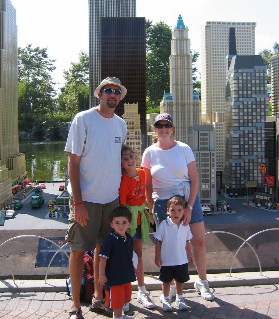 The late Jeff Berkowitz, left, with his wife Debbie, right, and their daughter Abrie, center, and their twin sons Evan and Seth.jpeg