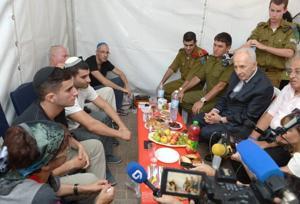 Peres visits bereaved families