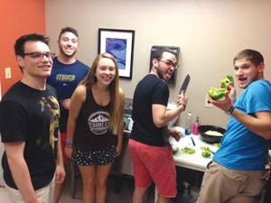 <p><span>During finals week, students prepare a gourmet midnight breakfast at the Chabad Jewish Student Center. Pictured, from left, are Loren Murphy, Aaron Bukani, Rachel Poulin, Itai Kreisler and Jonathan Wasserman.                                                   </span></p><p><span><em> </em></span></p>