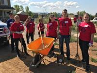 <p>Several Care-A-Van participants take a quick break while doing cleanup on a Habitat for Humanity property in Durango, Colorado, last month.</p>