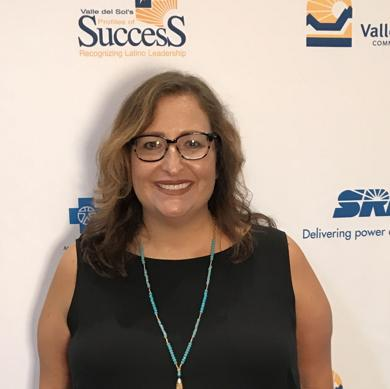 <p>Writer Mónica Brown receives the Valle del Sol's Latino Excellence in Arts, Culture & Literature Award.</p>