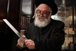 <p>Rabbi Yitzchak Eliezer Yakav, chief slaughterer from the Chief Rabbinate of Israel, is responsible for kosher slaughter of cattle imported to Israel from South America.</p>