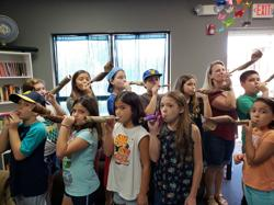 <p>Students at Desert Jewish Academy blow their makeshift shofars. Desert Jewish Academy is one of the Valley's six Jewish Day Schools supported by the JTO.</p>