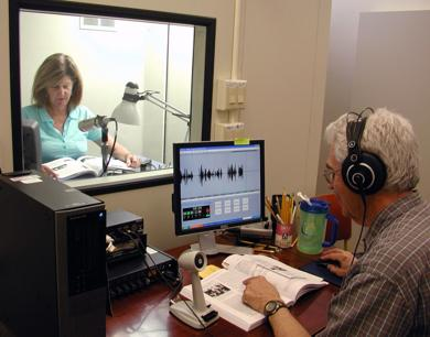 <p>An Arizona Talking Book Library recording session for local reading material. The program relies on volunteers as both readers and technicians.</p>