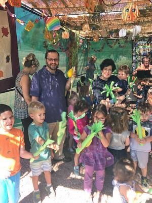 Having fun in the sukkah